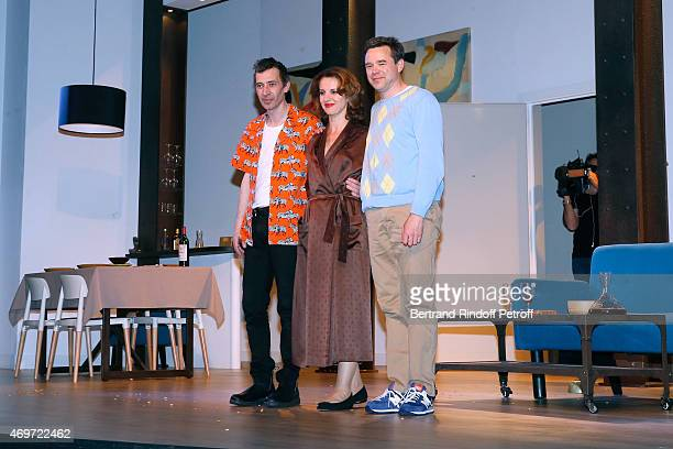Actors Eric Elmosnino Lysiane Meis and Guillaume de Tonquedec acknowledge the applause of the audience at the end of 'Un Diner d'Adieu' 200th Show at...