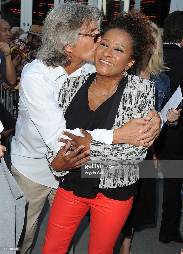 Actors Eric Roberts and Wanda Sykes arrive at the premiere of 'The Hot Flashes' at ArcLight Cinemas on June 27, 2013 in Hollywood, California.
