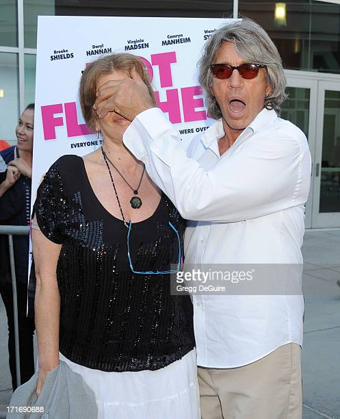 Actors Eric Roberts and wife Eliza Roberts arrive at the Los Angeles premiere of 'The Hot Flashes' at ArcLight Cinemas on June 27 2013 in Hollywood...