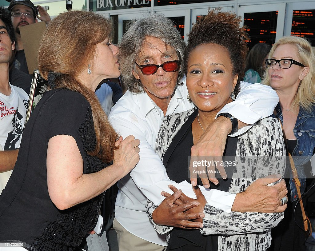 Actors Eric Roberts (C) and wife Eliza Roberts with Wanda Sykes arrive at the premiere of 'The Hot Flashes' at ArcLight Cinemas on June 27, 2013 in Hollywood, California.
