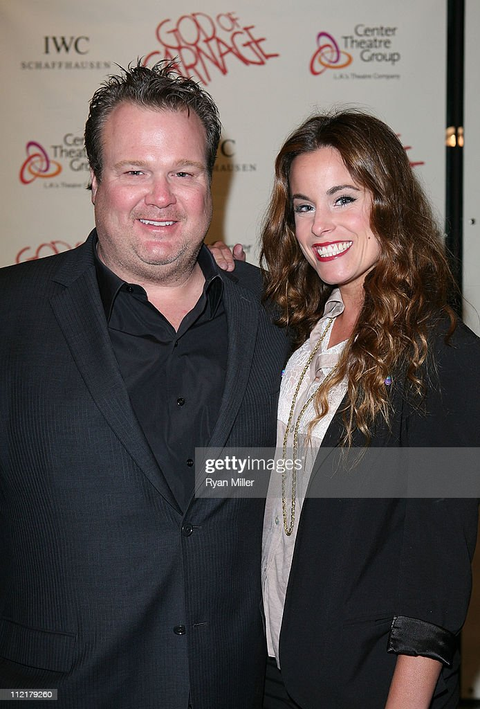 Actors Eric Stonestreet (L) and Katherine Tokarz (R) pose during the arrivals for the opening night performance of 'God of Carnage' at Center Theatre Group's Ahmanson Theatre on April 13, 2011 in Los Angeles, California.