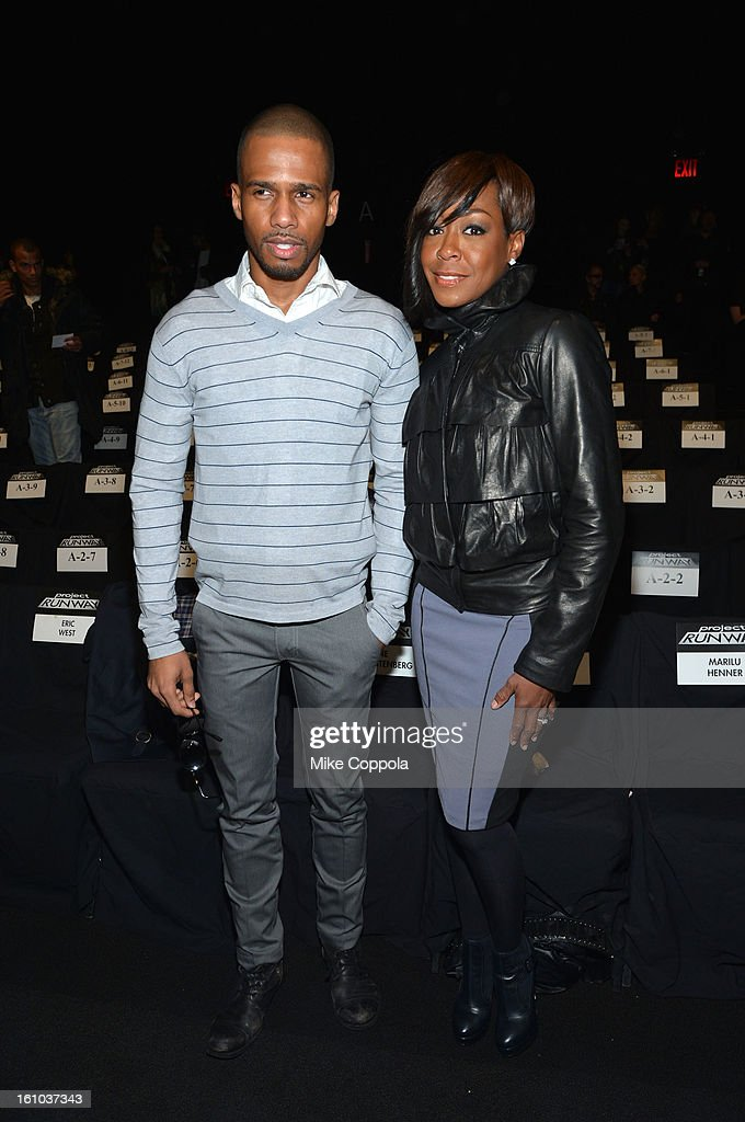 Actors Eric West and <a gi-track='captionPersonalityLinkClicked' href=/galleries/search?phrase=Tichina+Arnold&family=editorial&specificpeople=593825 ng-click='$event.stopPropagation()'>Tichina Arnold</a> attend the Project Runway Fall 2013 fashion show during Mercedes-Benz Fashion Week at The Theatre at Lincoln Center on February 8, 2013 in New York City.