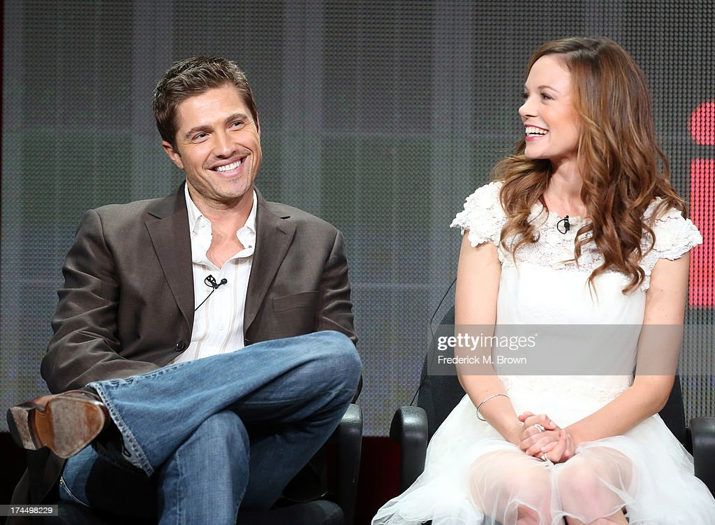 Actors <a gi-track='captionPersonalityLinkClicked' href=/galleries/search?phrase=Eric+Winter&family=editorial&specificpeople=226524 ng-click='$event.stopPropagation()'>Eric Winter</a> and <a gi-track='captionPersonalityLinkClicked' href=/galleries/search?phrase=Rachel+Boston&family=editorial&specificpeople=212849 ng-click='$event.stopPropagation()'>Rachel Boston</a> speak onstage during the 'Witches of East End' panel discussion at the Lifetime portion of the 2013 Summer Television Critics Association tour - Day 3 at the Beverly Hilton Hotel on July 26, 2013 in Beverly Hills, California.