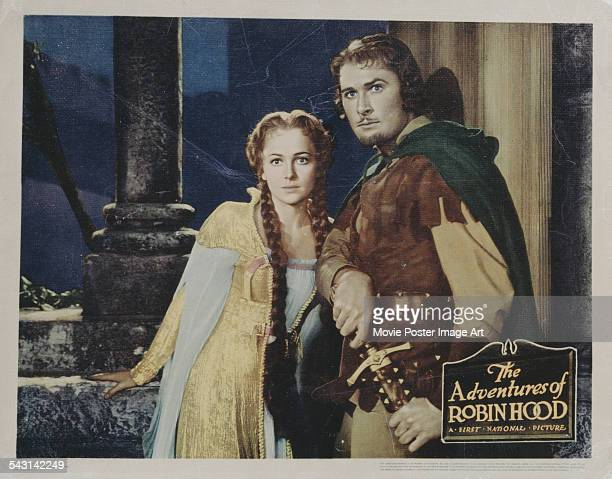 Actors Errol Flynn and Olivia de Havilland appear as Robin Hood and Maid Marion on a poster for the Warner Bros/First National Picture 'The...