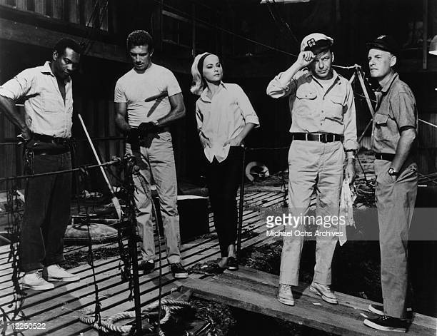 Actors Errol John Anthony Franciosa Virna Lisi Frank Sinatra and Alf Kjellin in a scene from the movie 'Assault On A Queen' in 1966
