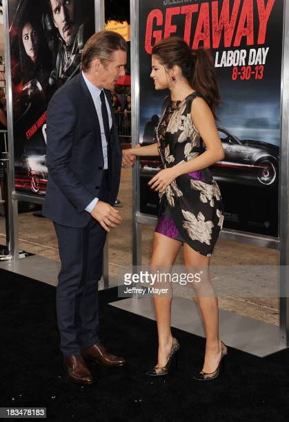 Actors Ethan Hawke and Selena Gomez arrive at the 'Getaway' Los Angeles Premiere at Regency Village Theatre on August 26 2013 in Westwood California