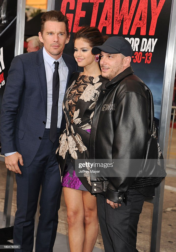 Actors <a gi-track='captionPersonalityLinkClicked' href=/galleries/search?phrase=Ethan+Hawke&family=editorial&specificpeople=178274 ng-click='$event.stopPropagation()'>Ethan Hawke</a> (L), <a gi-track='captionPersonalityLinkClicked' href=/galleries/search?phrase=Selena+Gomez&family=editorial&specificpeople=4295969 ng-click='$event.stopPropagation()'>Selena Gomez</a> (C) and director <a gi-track='captionPersonalityLinkClicked' href=/galleries/search?phrase=Courtney+Solomon&family=editorial&specificpeople=2167140 ng-click='$event.stopPropagation()'>Courtney Solomon</a> arrive at the 'Getaway' - Los Angeles Premiere at Regency Village Theatre on August 26, 2013 in Westwood, California.