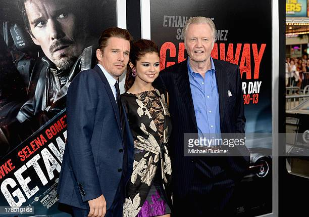 Actors Ethan Hawke Selena Gomez and Jon Voight arrive at the global 'Getaway' movie premiere featuring the Shelby GT500 Super Snake on the red carpet...