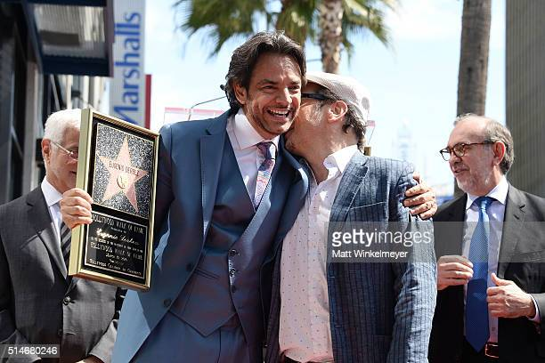 Actors Eugenio Derbez and Rob Schneider pose for a photo as Eugenio Derbez is honored with a Star on the Hollywood Walk of Fame on March 10 2016 in...
