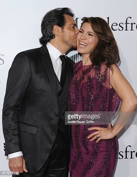 Actors Eugenio Derbez and wife Alessandra Rosaldo arrive at the premiere of Columbia Pictures' 'Miracles From Heaven' at ArcLight Hollywood on March...