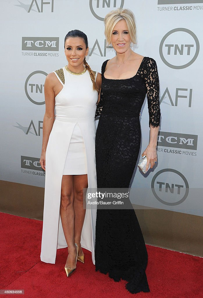 Actors <a gi-track='captionPersonalityLinkClicked' href=/galleries/search?phrase=Eva+Longoria&family=editorial&specificpeople=202082 ng-click='$event.stopPropagation()'>Eva Longoria</a> and <a gi-track='captionPersonalityLinkClicked' href=/galleries/search?phrase=Felicity+Huffman&family=editorial&specificpeople=201903 ng-click='$event.stopPropagation()'>Felicity Huffman</a> arrive at the 2014 AFI Life Achievement Award Gala Tribute at Dolby Theatre on June 5, 2014 in Hollywood, California.