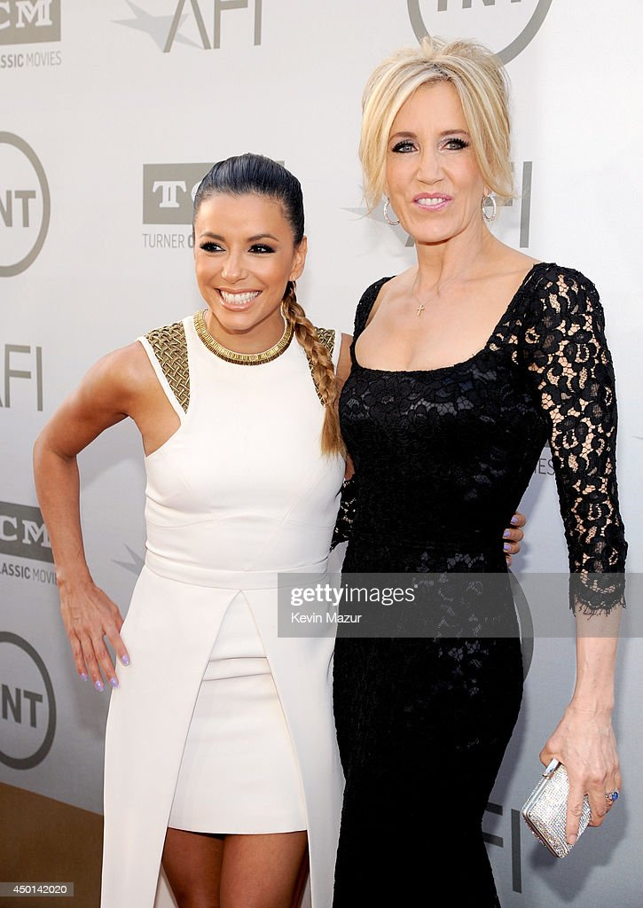 Actors Eva Longoria (L) and Felicity Huffman attend the 2014 AFI Life Achievement Award: A Tribute to Jane Fonda at the Dolby Theatre on June 5, 2014 in Hollywood, California. Tribute show airing Saturday, June 14, 2014 at 9pm ET/PT on TNT.