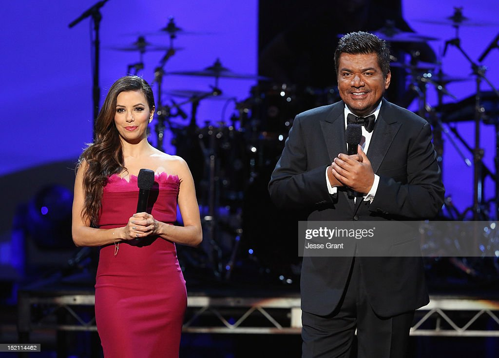 Actors <a gi-track='captionPersonalityLinkClicked' href=/galleries/search?phrase=Eva+Longoria&family=editorial&specificpeople=202082 ng-click='$event.stopPropagation()'>Eva Longoria</a> and <a gi-track='captionPersonalityLinkClicked' href=/galleries/search?phrase=George+Lopez&family=editorial&specificpeople=202546 ng-click='$event.stopPropagation()'>George Lopez</a> onstage at the 2012 NCLR ALMA Awards at Pasadena Civic Auditorium on September 16, 2012 in Pasadena, California.