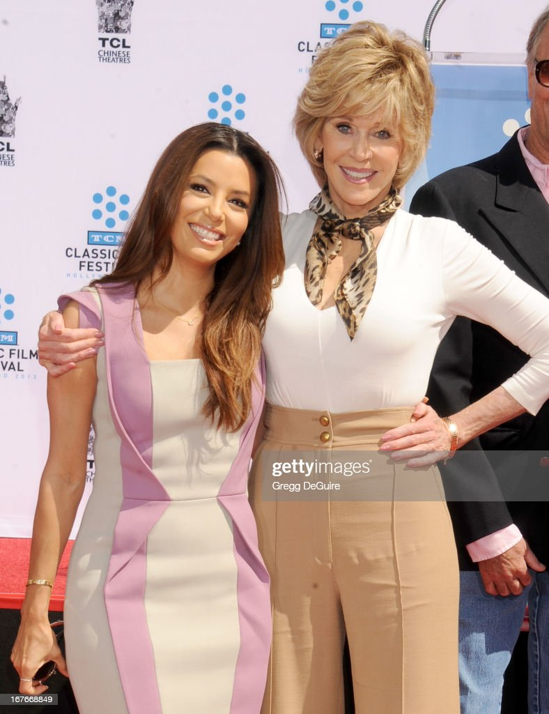 Actors Eva Longoria and Jane Fonda pose at Jane Fonda's hand and footprints ceremony at TCL Chinese Theatre on April 27, 2013 in Hollywood, California.