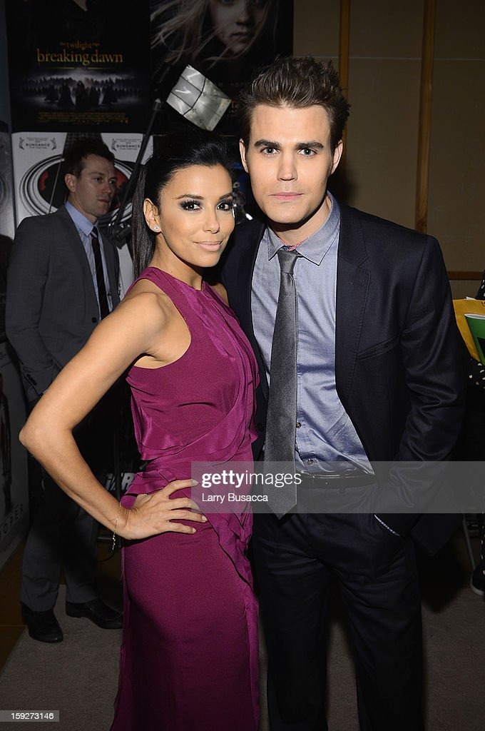 Actors <a gi-track='captionPersonalityLinkClicked' href=/galleries/search?phrase=Eva+Longoria&family=editorial&specificpeople=202082 ng-click='$event.stopPropagation()'>Eva Longoria</a> and <a gi-track='captionPersonalityLinkClicked' href=/galleries/search?phrase=Paul+Wesley&family=editorial&specificpeople=693176 ng-click='$event.stopPropagation()'>Paul Wesley</a> attend the 18th Annual Critics' Choice Movie Awards held at Barker Hangar on January 10, 2013 in Santa Monica, California.