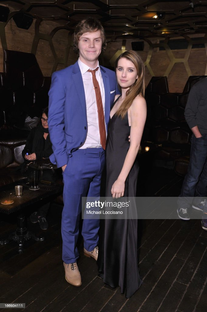 Actors <a gi-track='captionPersonalityLinkClicked' href=/galleries/search?phrase=Evan+Peters&family=editorial&specificpeople=2301160 ng-click='$event.stopPropagation()'>Evan Peters</a> (L) and <a gi-track='captionPersonalityLinkClicked' href=/galleries/search?phrase=Emma+Roberts&family=editorial&specificpeople=226535 ng-click='$event.stopPropagation()'>Emma Roberts</a> attend the 'Adult World' premiere after party during the 2013 Tribeca Film Festival at Darby Downstairs on April 18, 2013 in New York City.