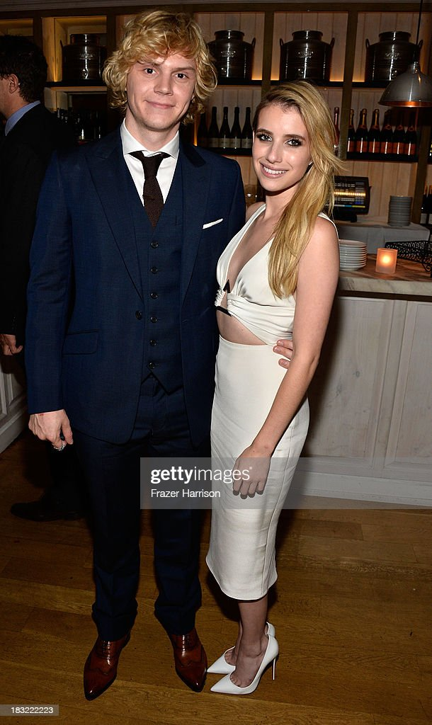 Actors Evan Peters and <a gi-track='captionPersonalityLinkClicked' href=/galleries/search?phrase=Emma+Roberts&family=editorial&specificpeople=226535 ng-click='$event.stopPropagation()'>Emma Roberts</a> attend the Premiere Of FX's 'American Horror Story: Coven' after party at Fig & Olive Melrose Place on October 5, 2013 in West Hollywood, California.