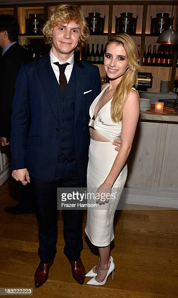 Actors Evan Peters and Emma Roberts attend the Premiere Of FX's 'American Horror Story Coven' after party at Fig Olive Melrose Place on October 5...