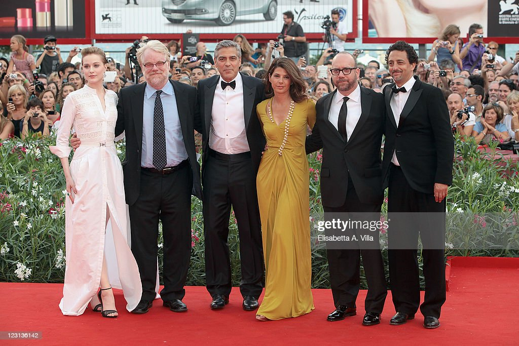 Actors Evan Rachel Wood, Philip Seymour Hoffman, director George Clooney and actors Marisa Tomei, Paul Giamatti and writer Grant Heslov attend 'The Ides Of March' premiere during the 68th Venice Film Festival at the Palazzo del Cinema on August 31, 2011 in Venice, Italy.