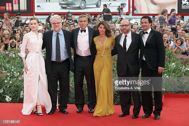 Actors Evan Rachel Wood Philip Seymour Hoffman director George Clooney and actors Marisa Tomei Paul Giamatti and writer Grant Heslov attend 'The Ides...