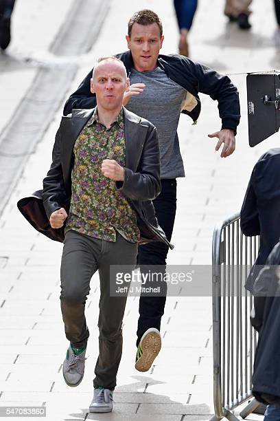 Actors Ewan McGregor and Ewan Bremner run on the set of the Trainspotting film sequel on Princess Street on July 13 2016 in Edinburgh Scotland The...