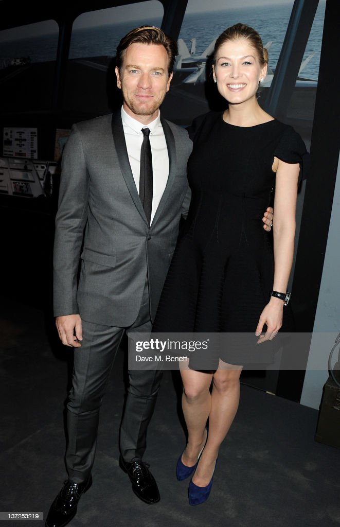 Actors <a gi-track='captionPersonalityLinkClicked' href=/galleries/search?phrase=Ewan+McGregor&family=editorial&specificpeople=202863 ng-click='$event.stopPropagation()'>Ewan McGregor</a> (L) and <a gi-track='captionPersonalityLinkClicked' href=/galleries/search?phrase=Rosamund+Pike&family=editorial&specificpeople=208910 ng-click='$event.stopPropagation()'>Rosamund Pike</a> attend the IWC Top Gun Gala Event at 22nd SIHH High Jewellery Fair on at the Palexpo Exhibition Hall January 17, 2012 in Geneva, Switzerland.