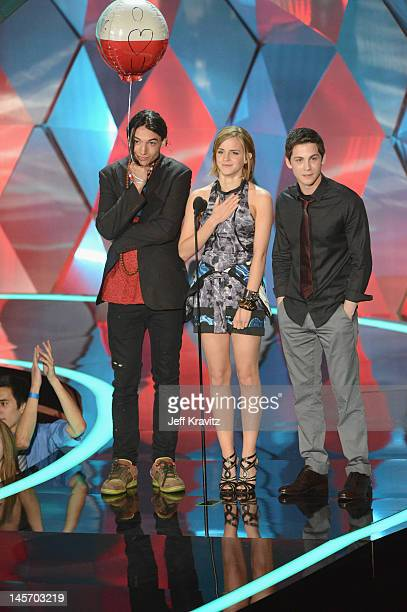 Actors Ezra Miller Emma Watson and Logan Lerman onstage at the 2012 MTV Movie Awards at Gibson Amphitheatre on June 3 2012 in Universal City...