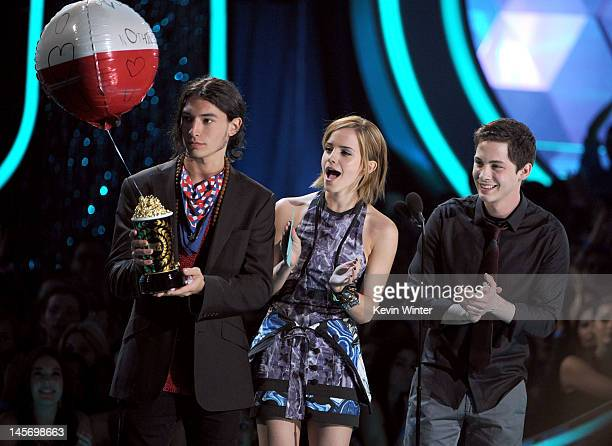 Actors Ezra Miller Emma Watson and Logan Lerman present an award onstage during the 2012 MTV Movie Awards held at Gibson Amphitheatre on June 3 2012...