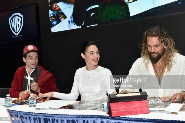 Actors Ezra Miller Gal Gadot and Jason Momoa during the 'Justice League' autograph signing at ComicCon International 2017 at San Diego Convention...
