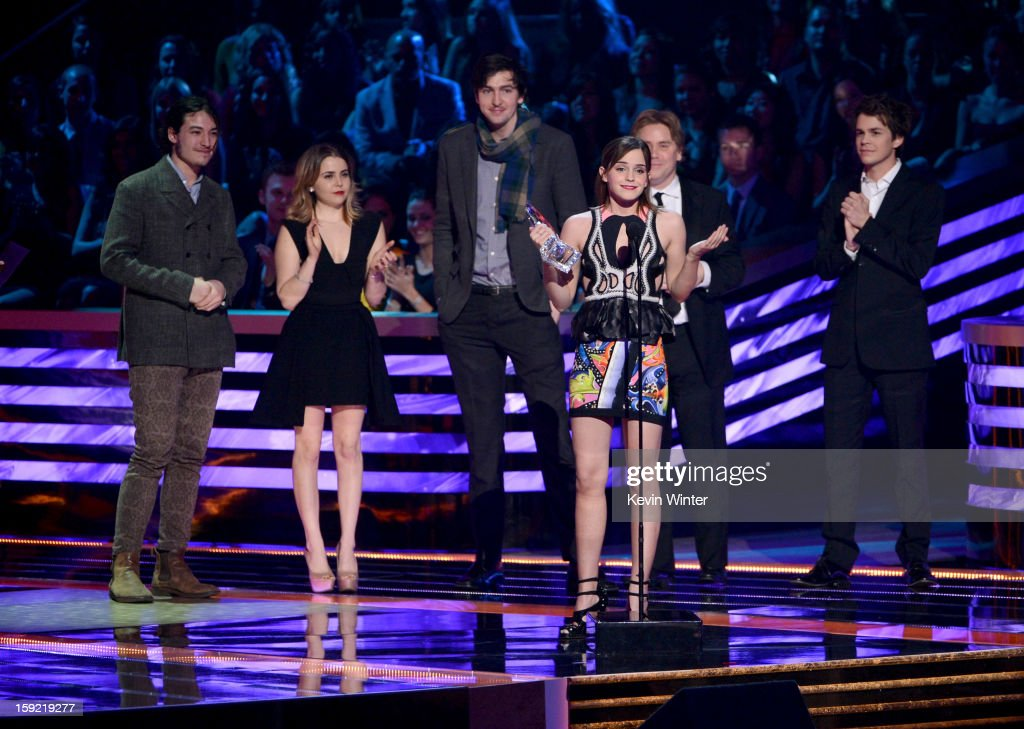 Actors Ezra Miller, Mae Whitman, Nicholas Braun, Emma Watson (speaking at microphone), writer-director Stephen Chbosky and actor Johnny Simmons, winners of Favorite Drama Movie for 'The Perks of Being a Wallflower,' onstage at the 39th Annual People's Choice Awards at Nokia Theatre L.A. Live on January 9, 2013 in Los Angeles, California.