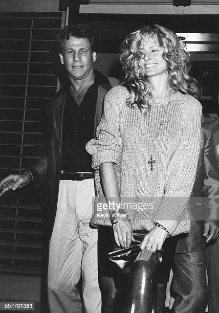 Actors Farrah Fawcett and Ryan O'Neal leaving Nicky Blair's restaurant after attending the birthday party of Tina Sinatra Los Angeles circa 1980