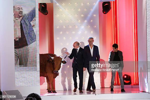Actors Fatsah Bouyahmed Lambert Wilson Jamel Debbouze and a cow present the Movie 'La Vache' during the 'Vivement Dimanche' French TV Show at...