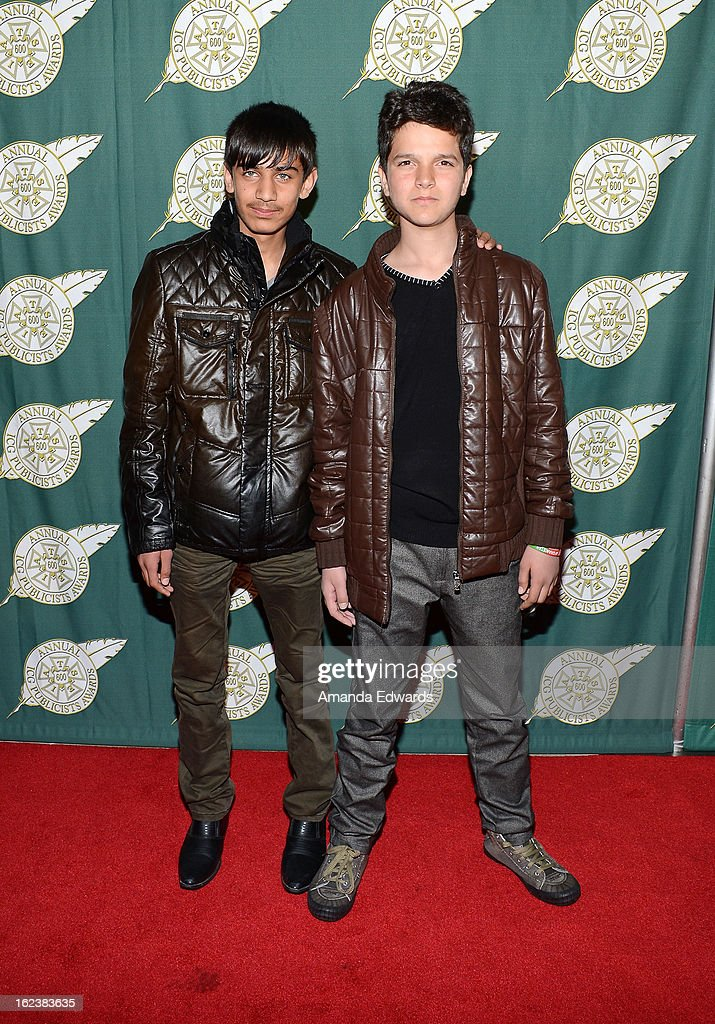 Actors Fawad Mohammadi (L) and Jawanmard Paiz arrive at the ICG 50th Annual Publicists Awards at The Beverly Hilton Hotel on February 22, 2013 in Beverly Hills, California.