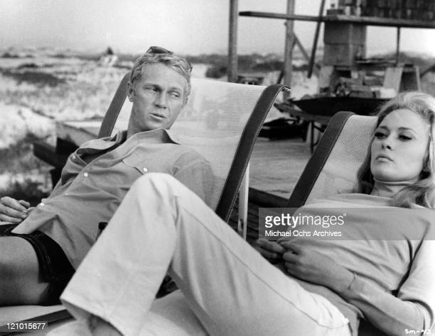 Actors Faye Dunaway and Steve McQueen relax on lounge chairs in a scene from the movie 'The Thomas Crown Affair' which was released on June 19 1968