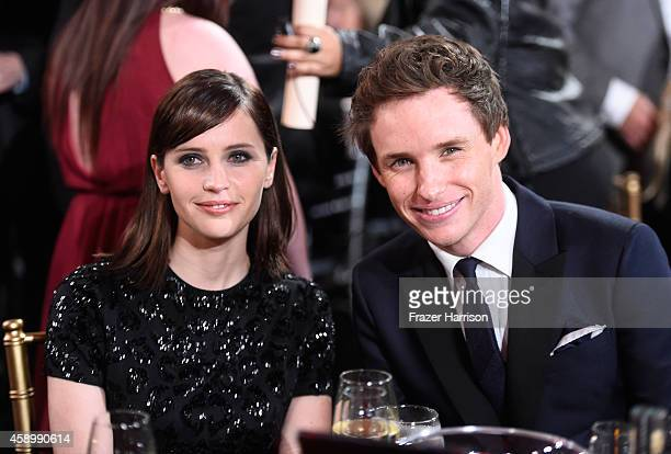 Actors Felicity Jones and Eddie Redmayne attend the 18th Annual Hollywood Film Awards at The Palladium on November 14 2014 in Hollywood California