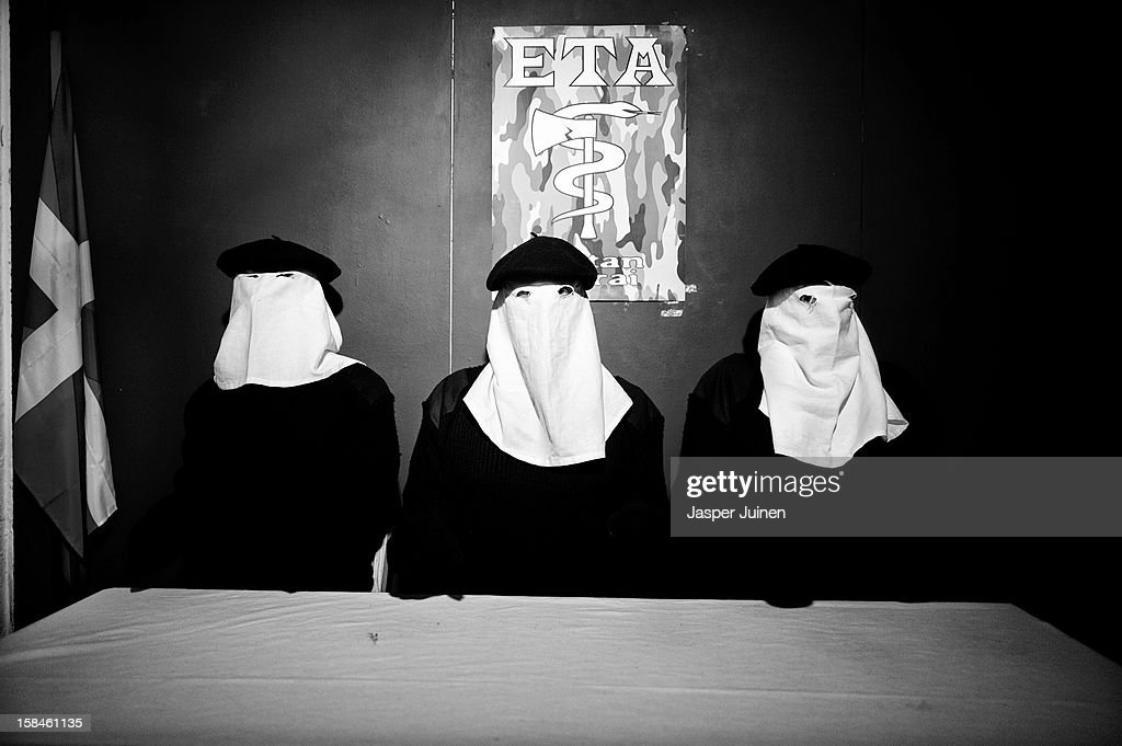 Actors Fernando Sola and Rodrigo Poison play members of the Basque Separatist militant group ETA during their 'No Abortamos' micro theater show at the 'Micro Teatro por Dinero' on December 15, 2012 in Madrid, Spain. In November 2009, fifty artists presented a theatre project in the thirteen rooms of a former brothel, two weeks before its demolition, with each function lasting less than 10 minutes. The initiative was a huge success, with more people queueing up outside than could enter. Today's 'Micro Theatre For Money' is named after the former brothel on Ballesta Street, and offers a cheap and original way for going out at night, especially in times of financial hardship. With each show priced at 4 Euros, over 150,000 spectators have already attended performances at the tiny theatre in the Malasana area. Anyone can submit a project to be chosen to perform for a month in one of the five tiny rooms in the basement of the theatre, making it an ideal platform for young Spanish authors and actors, often unemployed, to perform.