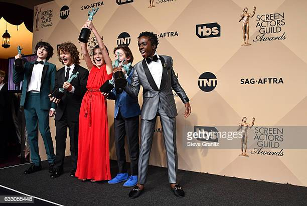 Actors Finn Wolfard Gaten Matarazzo Millie Bobby Brown Caleb McLaughlin and Noah Schapp winners of the Outstanding Ensemble in a Drama Series award...