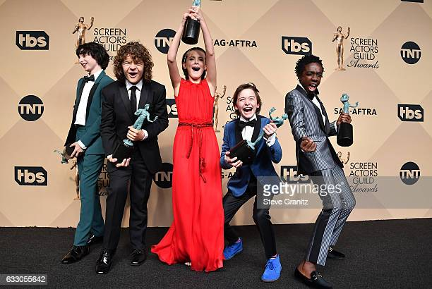 Actors Finn Wolfard Gaten Matarazzo Millie Bobby Brown Noah Schapp and Caleb McLaughlin winners of the Outstanding Ensemble in a Drama Series award...