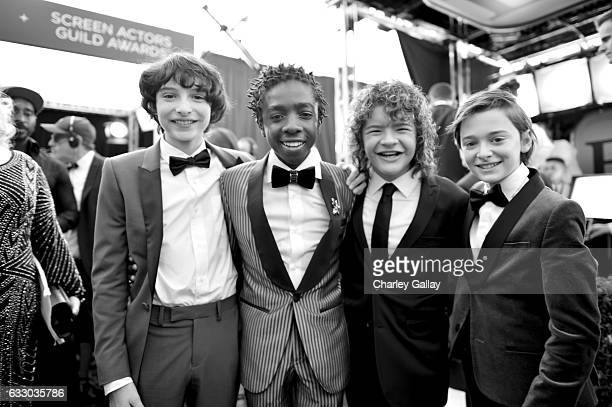 Actors Finn Wolfhard Caleb McLaughlin Gaten Matarazzo and Noah Schnapp attend The 23rd Annual Screen Actors Guild Awards at The Shrine Auditorium on...