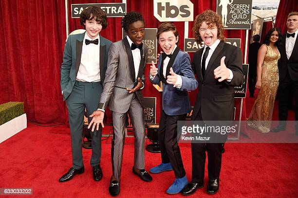 Actors Finn Wolfhard Caleb McLaughlin Noah Schnapp and Gaten Matarazzo attend The 23rd Annual Screen Actors Guild Awards at The Shrine Auditorium on...