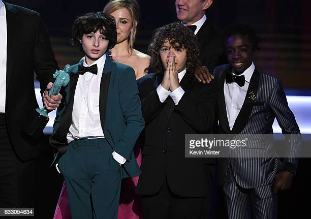 Actors Finn Wolfhard Gaten Matarazzo and Caleb McLaughlin of 'Stranger Things' accept Outstanding Performance by an Ensemble in a Drama Series...