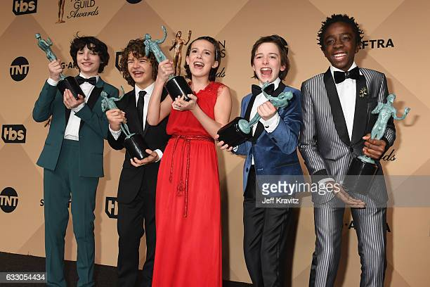 Actors Finn Wolfhard Gaten Matarazzo Millie Bobby Brown Noah Schapp and Caleb McLaughlin winners of the Outstanding Ensemble in a Drama Series award...