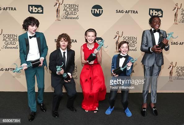 Actors Finn Wolfhard Gaten Matarazzo Millie Bobby Brown Noah Schapp and Caleb McLaughlin winners of the Outstanding Ensemble in a Drama Series award...