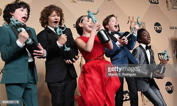 Actors Finn Wolfhard Gaten Matarazzo Millie Bobby Brown Noah Schnapp and Caleb McLaughlin corecipients of the Outstanding Performance by an Ensemble...