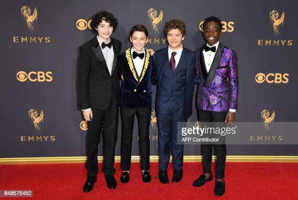 Actors Finn Wolfhard Noah Schnapp Gaten Matarazzo and Caleb McLaughlin arrive for the 69th Emmy Awards at the Microsoft Theatre on September 17 2017...