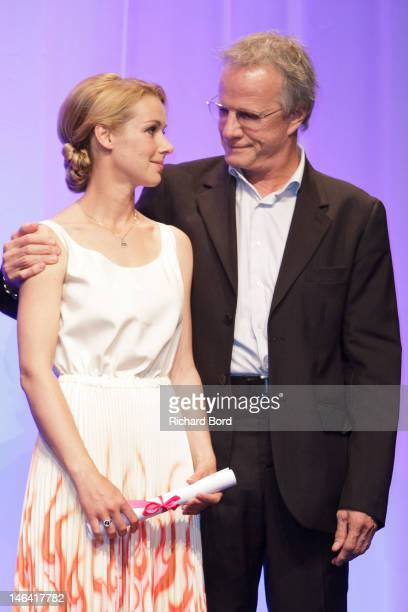 Actors Fleur Lise Heuet and Christophe Lambert attend the award ceremony during the 26th Cabourg Romantic Film Festival awards ceremony on June 15...