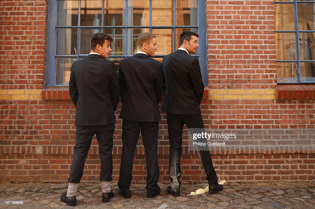 Actors Florian Wuensche, Dominic Saleh-Zaki and Jo Weil pretend to take a leak during the 18th anniversary celebration of the TV-show 'Verbotene Liebe' on April 22, 2013 in Hamburg, Germany.