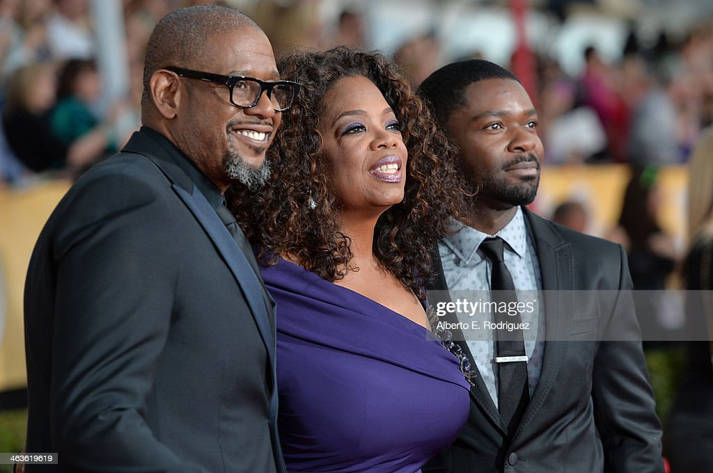 Actors <a gi-track='captionPersonalityLinkClicked' href=/galleries/search?phrase=Forest+Whitaker&family=editorial&specificpeople=226590 ng-click='$event.stopPropagation()'>Forest Whitaker</a>, <a gi-track='captionPersonalityLinkClicked' href=/galleries/search?phrase=Oprah+Winfrey&family=editorial&specificpeople=171750 ng-click='$event.stopPropagation()'>Oprah Winfrey</a> and <a gi-track='captionPersonalityLinkClicked' href=/galleries/search?phrase=David+Oyelowo&family=editorial&specificpeople=633075 ng-click='$event.stopPropagation()'>David Oyelowo</a> attend the 20th Annual Screen Actors Guild Awards at The Shrine Auditorium on January 18, 2014 in Los Angeles, California.