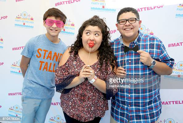 Actors Forrest Wheeler Raini Rodriguez and Rico Rodriguez pose at the Autograph Booth during the 17th Annual Mattel Party on the Pier on September 25...