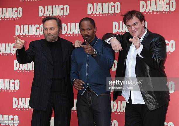 Actors Franco Nero Jamie Foxx and director Quentin Tarantino attend the 'Django Unchained' photocall at the Hassler Hotel on January 4 2013 in Rome...